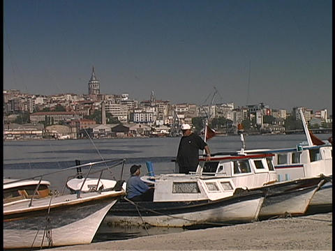 Fishing boats float at the docks at the Golden Horn in Istanbul, Turkey Footage