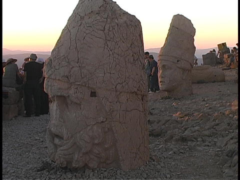 The broken heads of Zeus and Antioch lie on the ground at Mount Nemrut Footage