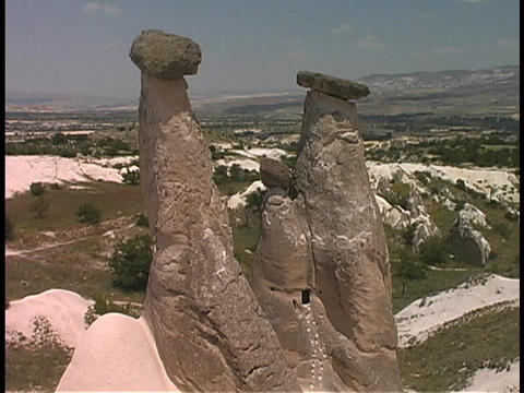 Fairy-chimney rock formations adorn the hills in Cappadocia, Turkey Footage