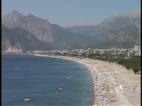 Tourists enjoy the beach at the Antalya coastline in Turkey Footage