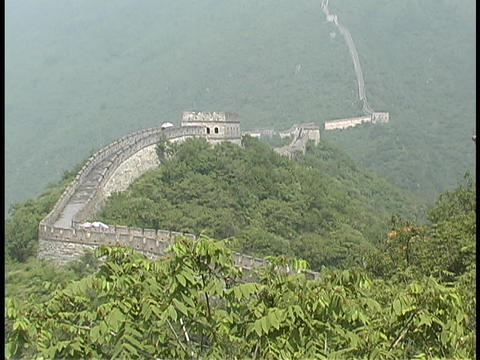 The Great Wall of China stretches across a mountain range Footage