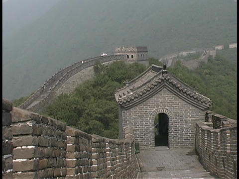 The Great Wall of China stretches through the jungle Stock Video Footage