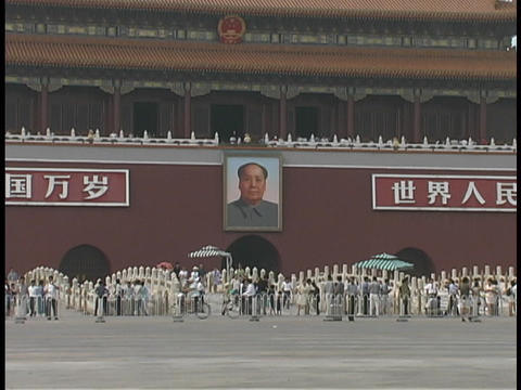 A poster of Mao Tse-tung hangs on a wall in Tiananmen Square Footage