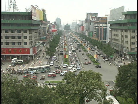 Traffic drives down a busy street in Xian, China Stock Video Footage