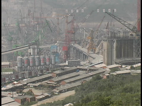 Cranes operate on a construction site at the Yangtze... Stock Video Footage
