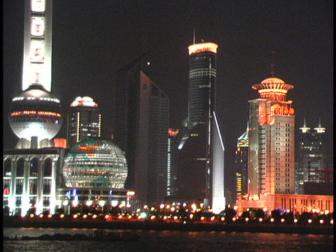 Shanghai skyscrapers light the night along the Huangpu River Stock Video Footage