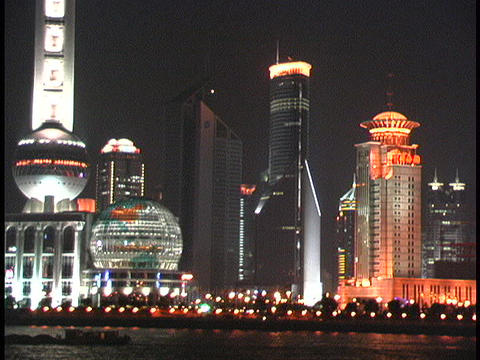 Shanghai skyscrapers light the night along the Huangpu River Footage