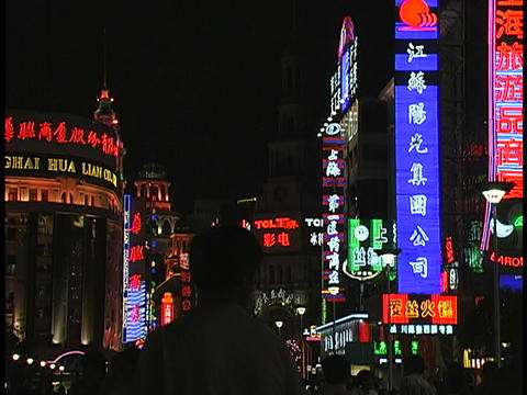 Colorful neon signs light up a shopping district of Shanghai at night Footage