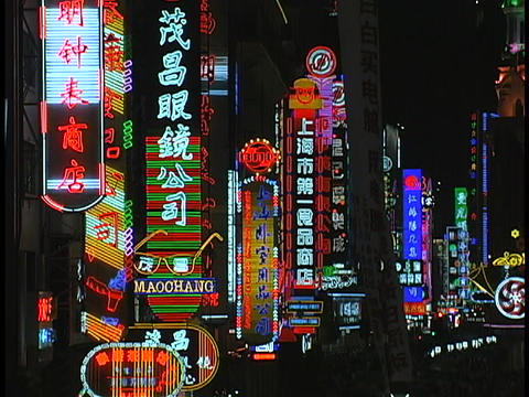 Colorful neon signs light up a shopping district of... Stock Video Footage