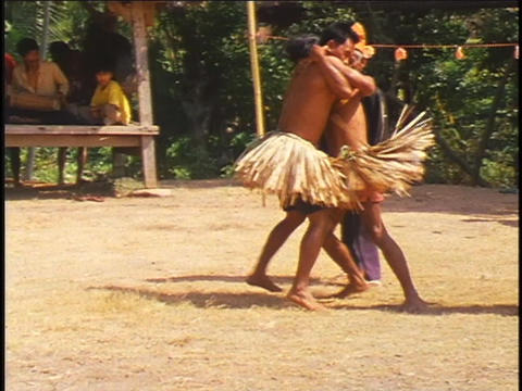 young men engage in a ritual wrestling match in Indonesia Stock Video Footage