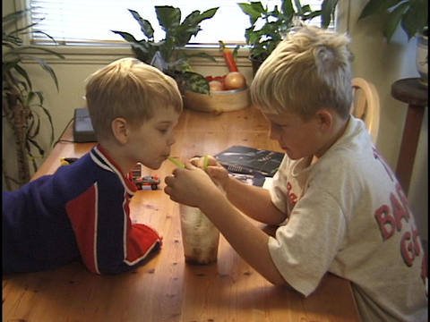young boys share a milkshake Stock Video Footage