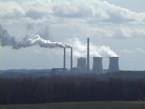 Smoke rises from the smokestacks of a nuclear power plant Stock Video Footage