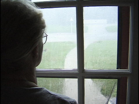 A women watches the rain outside the window Footage