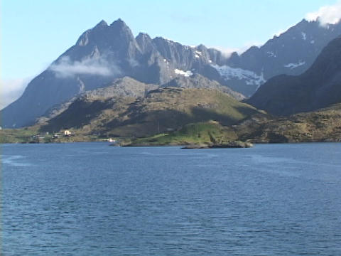 Mountains encompass a fjord in Norway Stock Video Footage