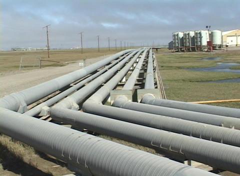 Panning-shot across pipes at a Halliburton facility in... Stock Video Footage