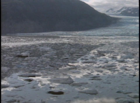 Chunks of ice float in a partially frozen river Stock Video Footage