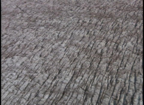 Ridges and crevasses mark the surface of a glacier Stock Video Footage