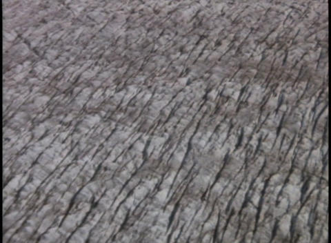 Ridges and crevasses mark the surface of a glacier Footage