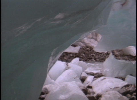 Water flows from melting ice Stock Video Footage