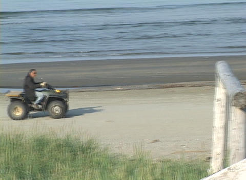 An Alaskan native drives an ATV past a sacred whalebone... Stock Video Footage