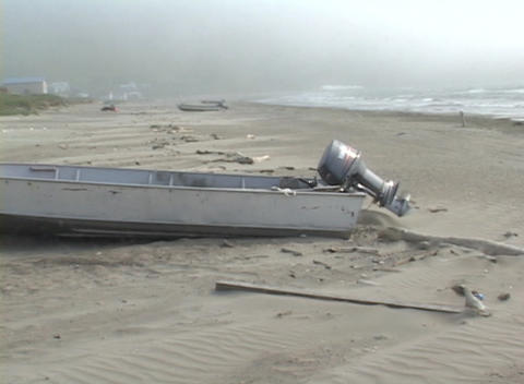 A motorboat lies deserted on a shore in a remote village... Stock Video Footage