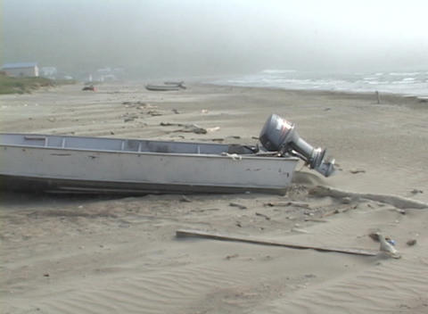 A motorboat lies deserted on a shore in a remote village in the Aleutian Islands Footage