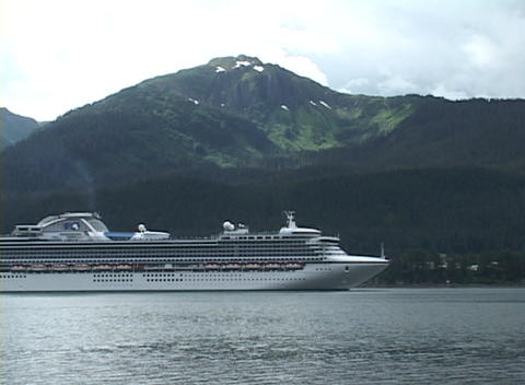A cruise ship floats in a harbor Footage