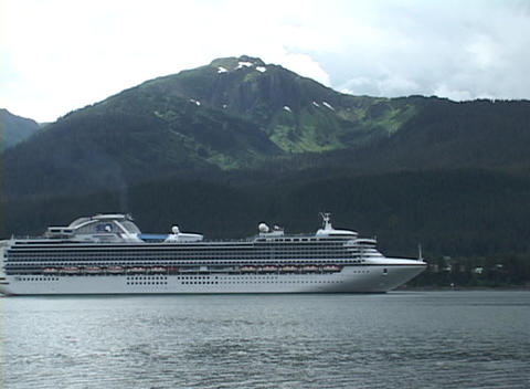 A cruise ship floats in a harbor Stock Video Footage