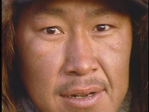 An Inuit Eskimo face looks forward Stock Video Footage