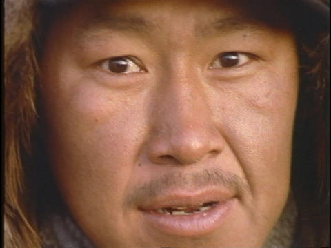 An Inuit Eskimo face looks forward Footage