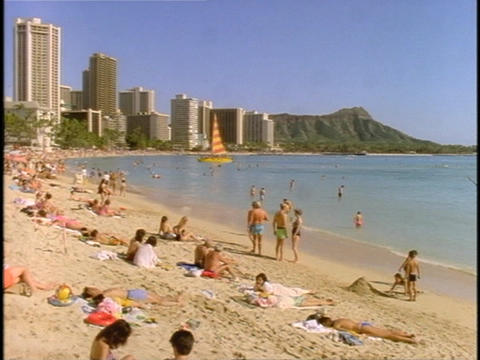 Tourists enjoy a beach at Honolulu Stock Video Footage