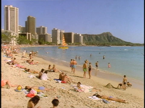 Tourists enjoy a beach at Honolulu Footage