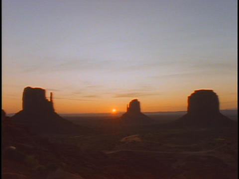 Giant rock formations rise from the desert floor of... Stock Video Footage