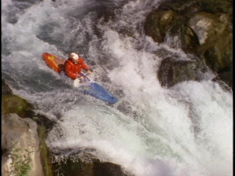 A kayaker plunges down steep rapids Footage