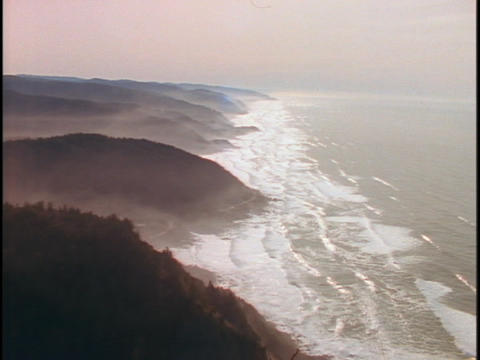 Tides roll into coves along the coastline of Northwest America Footage