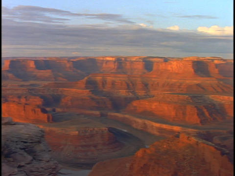 The walls of the Grand Canyon reflect orange light Footage