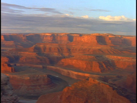 The walls of the Grand Canyon reflect orange light Stock Video Footage