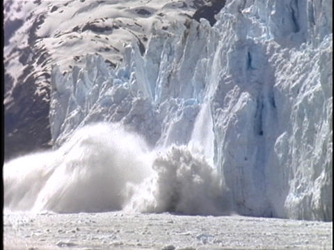 A large chunk of an Alaskan glacier falls into the sea Footage