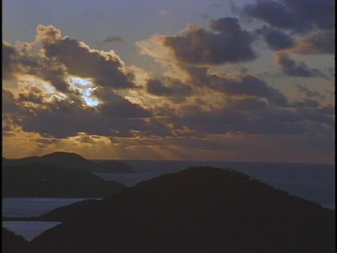 Clouds drift over a chain of Caribbean islands Live Action