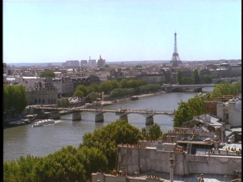 The Eiffel Tower rises above Paris and the Seine river Stock Video Footage