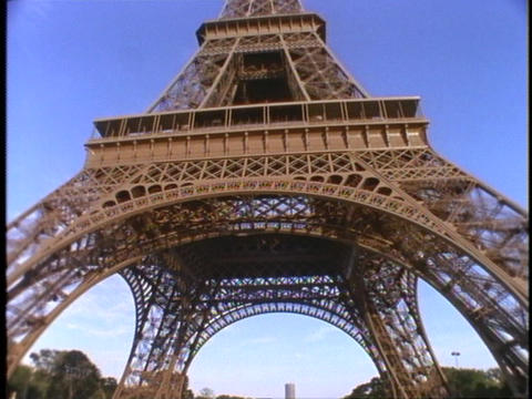 Visitors sit under the Eiffel Tower in Paris, France Footage