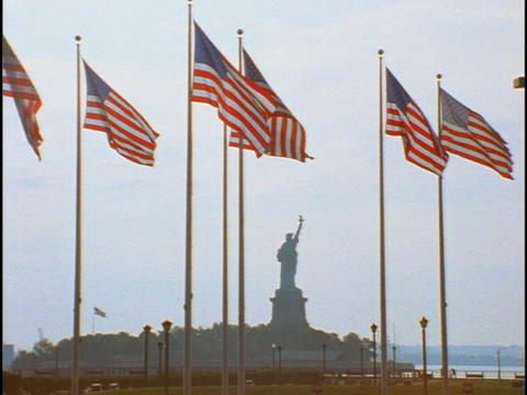 American flags fly at the Statue of Liberty Footage
