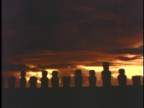 Easter Island statues stand in a row against the sky Footage