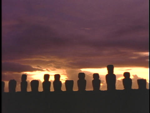Easter Island statues stand in a row against the sky Stock Video Footage