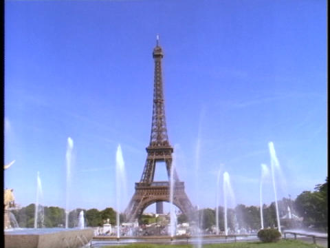 The Eiffel Tower rises high above a pool of fountains Stock Video Footage