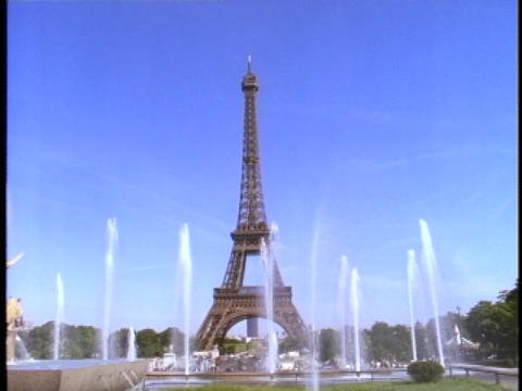 The Eiffel Tower rises high above a pool of fountains Footage