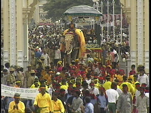 The Dasara festival in Mysore, India features crowds, dancers and decorated elephants Live Action