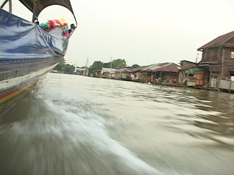 A boat travels along the Chao Phraya River in Bangkok Footage