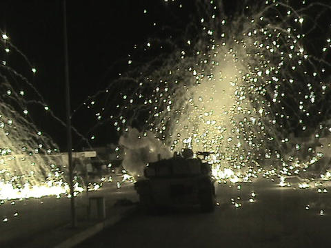 An Abrams tank fires into an Iraqi village Footage