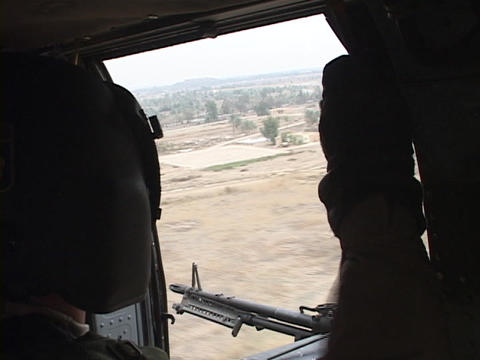 A military helicopter flies over Iraq Stock Video Footage